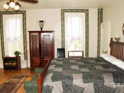 Master Suite on Second Floor, King Bed, sitting area, large bath, overlooking lake, patio